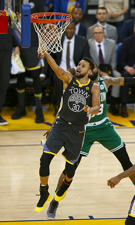 ©DANIEL GLUSKOTER Steph Curry drives to the basket on the way to a season high 49 points during the Warriors 109-105 win over the Boston Celtics Saturday night.