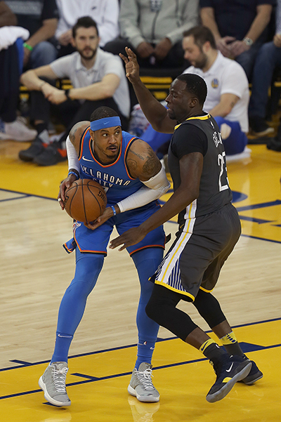 ©DANIEL GLUSKOTER Draymond Green (23) defends against Carmelo Anthony early in the Thunder's blow out win over the Warriors at Oracle Tuesday night.