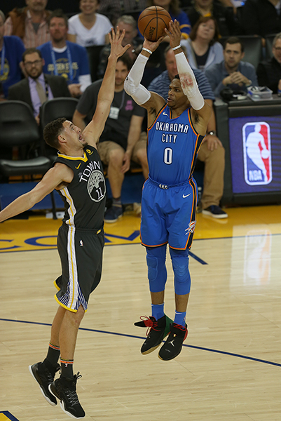©DANIEL GLUSKOTER Oklahoma City's Russell Westbrook goes up for a shot during the Thunder's 125-105 win over the Warriors Tuesday night. Westbrook scored 21 in the first quarter as OKC jumped out to a 42-30 lead and never trailed.