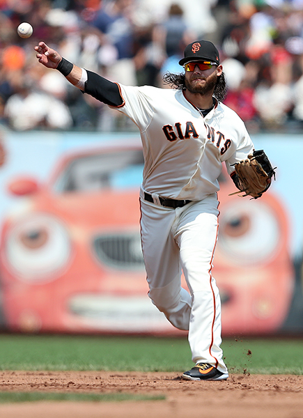 ©DANIEL GLUSKOTER Shortstop Brandon Crawford's offensive production slipped in 2017, but he was once again solid in the field, winning his third straight Gold Glove Award.
