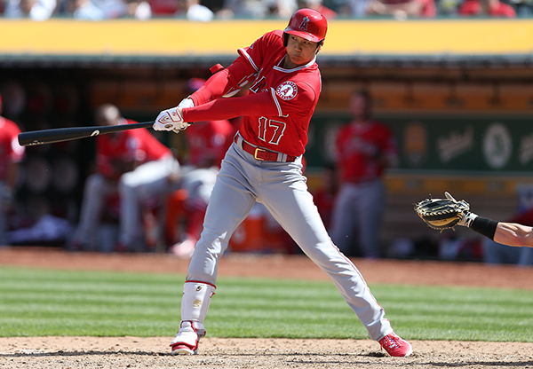 ©DANIEL GLUSKOTER Angels phenom Shohei Ohtani laced a single in his first Major League at bat during the A's season opening win over Los Angeles at the Coliseum.
