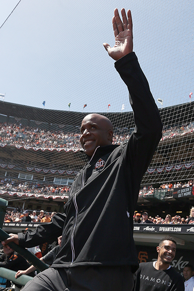 ©DANIEL GLUSKOTER   All-Time MLB home run king Barry Bonds waves to the crowd during pre-game festivities prior to the Giants home opener against the Seattle Mariners.