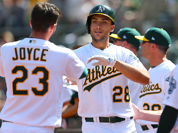 Olson's hit gives A's win in 14th inning