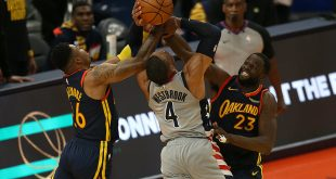 Beal's 4-point play stings Warriors in closing seconds, 110-107